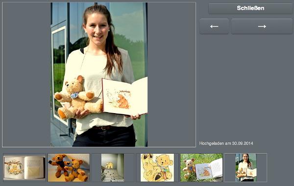 """Luisa Tegtmeyer mit ihrem Buch und dem Bären """"Buddy"""""""