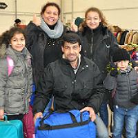 Neue Heimat GL kleidet Flüchtlinge ein