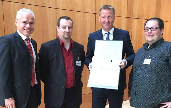 Minister Ralf Jäger mit Martin Wiegelmann, Thomas Winterscheid, Patrick Graf
