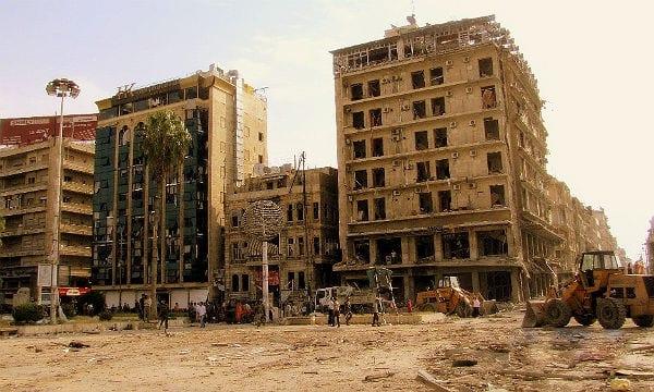 Nach Bombenanschlägen zerstörte Häuser in Syrien. Foto: Wikimedia